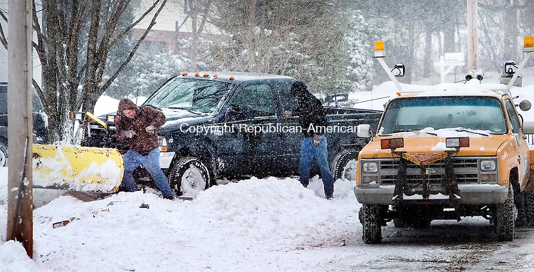WATERBURY, CT. 02 March 2009-030209SV06--Tow truck operators clear a plow truck from a tree after the driver had a heart attack and hit the tree and possibly a telephone pole while plowing on Juniper Ridge Rd in Waterbury Monday.<br /> Steven Valenti Republican-American