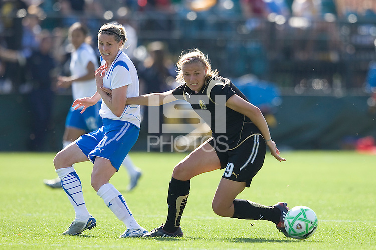 Kelley Smith, left, and Carrie Dew, right, battle for the ball. FC Gold Pride defeated the Boston Breakers 2-1 at Buck Shaw Stadium in Santa Clara, California on April 5th, 2009.