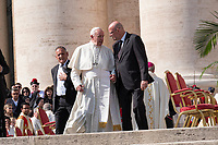 Vatican City, October 13, 2019. Pope Francis talks to Vatican security chief, Domenico Giani as they leave Saint Peter Square at the end of the canonization Mass in St. Peter's Square at the Vatican. Pope Francis on Sunday canonized Cardinal John Henry Newman, the 19th-century Anglican convert who became an immensely influential, unifying figure in both the Anglican and Catholic churches. Francis presided over Mass on Sunday in a packed St. Peter's Square to declare Newman and four women saints. (Antonello Nusca/BuenavistaPhoto)