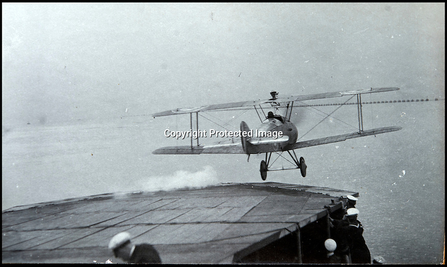 BNPS.co.uk (01202 558833)<br /> Pic: C&TAuctions/BNPS<br /> <br /> RNAS fighter attempting an early ship take off..<br /> <br /> Those not so magnificent men in their flying machines...<br /> <br /> A newly discovered album of of photographs from the First War illustrates the difficulties and dangers of the earliest days of flight.<br /> <br /> Thought to have been collected by an unknown officer at the RNAS school of flying at Cranwell during the war, the album catalogues the thrills and spills of a time before health and safety.<br /> <br /> Multiple collisions, perilous carrier take off's, impacts with phone lines, random trees and even buildings are all featured - as well as a visit from the King and Queen.<br /> <br /> C&T auctions are selling the unique album on Wednesday 30th March.