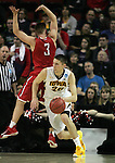 Iowa's Jarrod Uthoff (20) heads up court after grabbing a rebound from Davidson's Brian Sullivan (3)  during 2015 NCAA Division I Men's Basketball Championship March 20, 2015 at the Key Arena in Seattle, Washington.  Iowa beat Davidson 83-52.   ©2015. Jim Bryant Photo. ALL RIGHTS RESERVED.