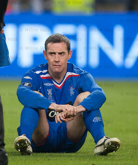 David Weir a bit shellshocked on the ground as he waits to go up to collect his runners up medal