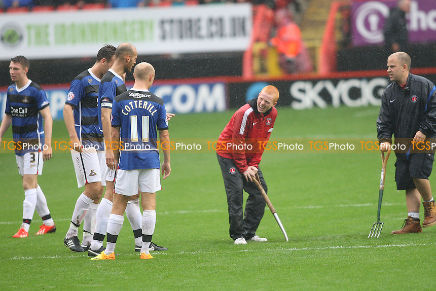 Doncaster players joke with the Charlton groundstaff as they clear the pitch after the match was suspended - Charlton Athletic vs Doncaster Rovers - Sky Bet Championship Football at The Valley, London - 24/08/13 - MANDATORY CREDIT: George Phillipou/TGSPHOTO - Self billing applies where appropriate - 0845 094 6026 - contact@tgsphoto.co.uk - NO UNPAID USE