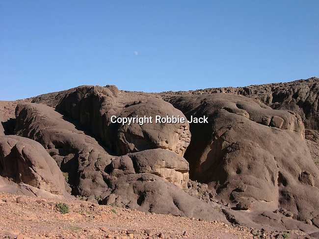 View towards the moon from the desert near the oasis at Fint in Morocco.