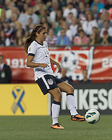 USWNT forward Alex Morgan (13) passes the ball.  In an international friendly, the U.S. Women's National Team (USWNT) (white/blue) defeated Korea Republic (South Korea) (red/blue), 4-1, at Gillette Stadium on June 15, 2013.