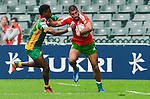 Portugal play Guyana on Day 1 of the 2012 Cathay Pacific / HSBC Hong Kong Sevens at the Hong Kong Stadium in Hong Kong, China on 23rd March 2012. Photo © Victor Fraile  / The Power of Sport Images