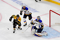 June 6, 2019: Boston Bruins left wing Jake DeBrusk (74), St. Louis Blues goaltender Jordan Binnington (50) and defenseman Carl Gunnarsson (4) track the flying puck during game 5 of the NHL Stanley Cup Finals between the St Louis Blues and the Boston Bruins held at TD Garden, in Boston, Mass. The Blues defeat the Bruins 2-1 in regulation time. Eric Canha/CSM