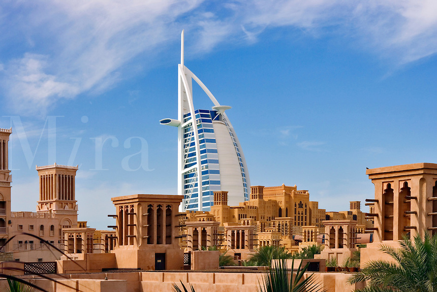 View over Al Qasr Hotel villas and Madinat Jumeirah souk towards Burj Al Arab and Mina a?Salam Hotel.  Dubai. United Arab Emirates.