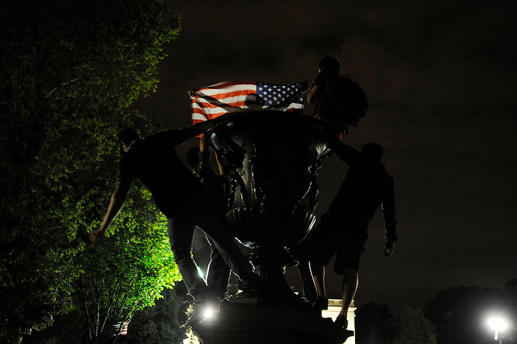 UNITED STATES - May 1:  Brian Baum, 19, with flag, of Georgetown University, celebrates with classmates in Lafayette Park across from the White House after President Obama announced Osama bin Laden was killed in a U.S. military operation in Pakistan.  (Photo By Tom Williams/Roll Call)
