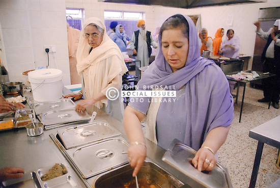 Asian women preparing food for the Baisakhi festival,