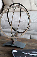 Modern metal sculpture on wooden coffee table