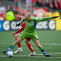 Freddie Ljungberg (10) from the Seattle Sounders FC battles for a ball with Carl Robinson (left) from Toronto FC during MLS action against Seattle at BMO Field in Toronto on April 4, 2009. Seattle won 2-0. Photo by Nick Turchiaro/isiphotos.com.