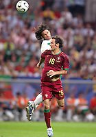 Jose Fonseca (17) of Mexico beats Ricardo Carvalho (16) of Portugal to a header. Portugal defeated Mexico 2-1 in their FIFA World Cup Group D match at FIFA World Cup Stadium, Gelsenkirchen, Germany, June 21, 2006.