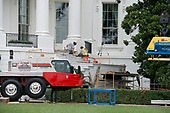 Stone masons work on the steps of the South Portico of the White House in Washington, DC as it is undergoing renovations while United States President Donald J. Trump is vacationing in Bedminster, New Jersey on Friday, August 11, 2017.<br /> Credit: Ron Sachs / CNP