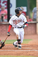 Elizabethton Twins second baseman Nelson Molina (12) swings at a pitch during a game against the Johnson City Cardinals on July 30, 2015 in Elizabethton, Tennessee. The Twins defeated the Cardinals 13-4. (Tony Farlow/Four Seam Images)