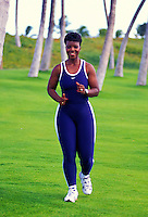 Lisa Banados walking and exercising at koolina beach, west Oahu