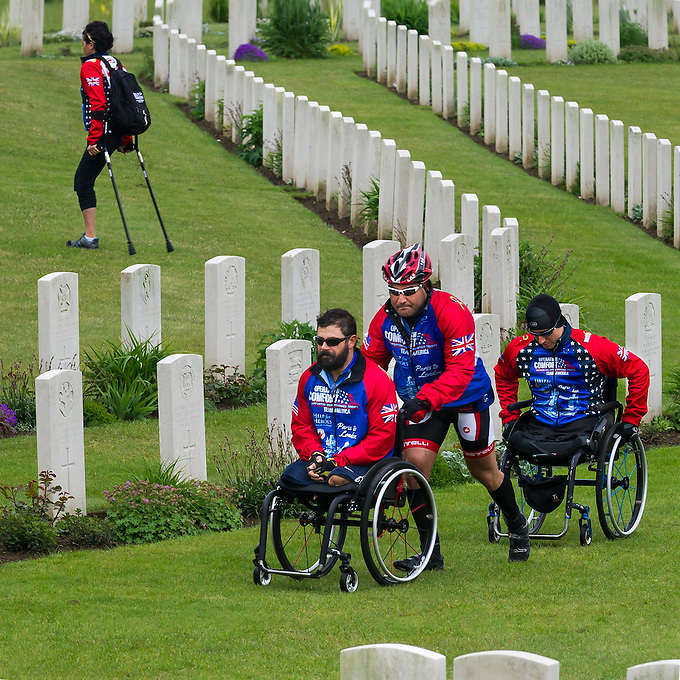 War wounded at the military cemetery at Etaples, the largest CWGC cemetery in France, containing 10,771 First World War burials of which only 35 remain unidentified, on the fourth day of the Help for Heroes Big Battlefields Bike Ride from Paris to London. The day commenced from Le Touquet and proceeded to Etaples, which had been home to the British Army's largest training camp during the Second World War, as well as having military prisons and hospitals. Here, in the War Cemetary at Etaples, in front of a memorial designed by Edwin Lutyens, a wreath laying ceremony was conducted. Lunch was taken just north of Boulogne, beside the Canadian Military Cemetary where Lt. Col. John McCrae was buried and a second wreath laying ceremony was held. Finally, before arriving at Calais, there was a visit to Mimoyecques, an old quarry from which the Germans created a substantial subterranean base, to house their V3 rocket, with which they hoped to destroy London. Friday 31st May 2013.