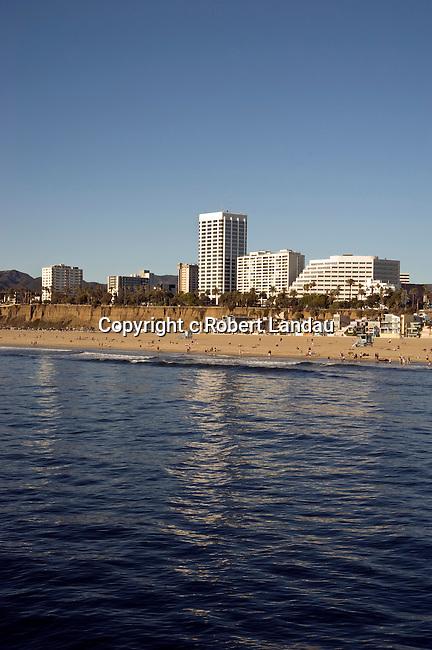 View of Santa Monica Beach with downtown Santa Monica and coastal mountains