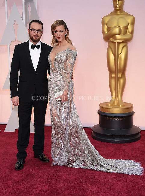 WWW.ACEPIXS.COM<br /> <br /> February 22 2015, LA<br /> <br /> Dana Brunetti and Katie Cassidy arriving at the 87th Annual Academy Awards at the Hollywood &amp; Highland Center on February 22, 2015 in Hollywood, California.<br /> <br /> By Line: Z15/ACE Pictures<br /> <br /> <br /> ACE Pictures, Inc.<br /> tel: 646 769 0430<br /> Email: info@acepixs.com<br /> www.acepixs.com