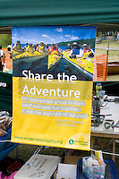 Poster at Wilderness Inquiry booth providing group canoe rides to all. Aquatennial Beach Bash Minneapolis Minnesota USA