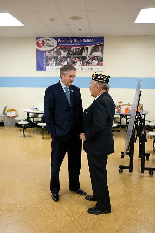 UNITED STATES - MARCH 15: Rep. John Tierney, D-Mass., left, speaks with a constituent during the Veterans Jobs and Benefits Fair at Peabody Veterans Memorial High School in Peabody, Mass., on March 15 , 2014. (Photo By Shira T. Center/CQ Roll Call)
