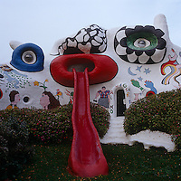 This sculptural house by Niki de Saint Phalle resembles the face of a cat, with a bright red slide representing a tongue