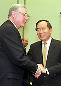United States Representative Dan Burton (Republican of Indiana), Chairman, U.S. House Committee on Government Operations, greets former Democratic fund raiser John Huang before he testifies before the Committee to answer charges he arrange nearly one million dollars in illegal contributions for the Clinton-Gore re-election campaign in 1996 on 15 December, 1999.<br /> Credit: Ron Sachs / CNP