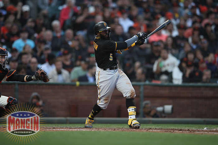 SAN FRANCISCO, CA - AUGUST 11:  Josh Harrison #5 of the Pittsburgh Pirates bats against the San Francisco Giants during the game at AT&T Park on Saturday, August 11, 2018 in San Francisco, California. (Photo by Brad Mangin)