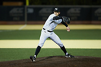 Wake Forest Demon Deacons relief pitcher Tyler Witt (12) in action against the Louisville Cardinals at David F. Couch Ballpark on March 6, 2020 in  Winston-Salem, North Carolina. The Cardinals defeated the Demon Deacons 4-1. (Brian Westerholt/Four Seam Images)