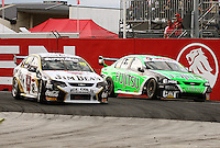 James Courtney (left) pushes inside Jason Bright on Holden Hairpin during Race Two during Day Three of the Hamilton 400 Aussie V8 Supercars Round Two at Frankton, Hamilton, New Zealand on Sunday, 19 April 2009. Photo: Dave Lintott / lintottphoto.co.nz