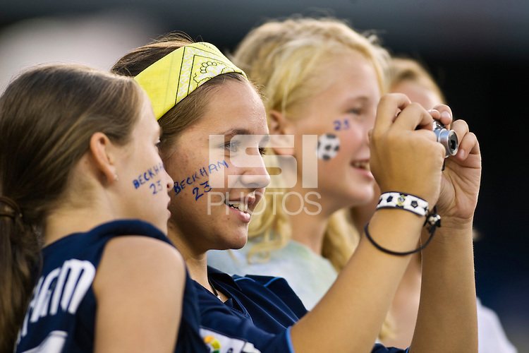 Fans of Los Angeles Galaxy midfielder David Beckham (23) (not pictured) look to take his picture during warmups. The New England Revolution and the Los Angeles Galaxy played to a 2-2 tie during an MLS regular season match at Gillette Stadium in Foxborough, MA, on August 30, 2008.