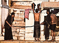 After taking holy bath in river Ganges, pilgrims are drying their clothes on the ghats. (Photo by Matt Considine - Images of Asia Collection)