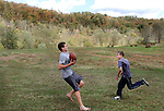 James G. Fletcher Collins, left, and Charles Andrew Collins play football with their brothers in their backyard in Jackson, Ky., on Friday Oct. 14, 2011. The four brothers spend a lot of time together playing football, hunting and trapping. Photo by Rachel Aretakis