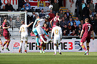 Pictured: Michel Vorm goalkeeper for Swansea (blue) deflects the ball, assisted by team mate Luke Moore and threatened by Edin Dzeko of Manchester City (10). Saturday 04 May 2013<br /> Re: Barclay's Premier League, Swansea City FC v Manchester City at the Liberty Stadium, south Wales.