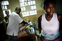 Tiangay weeps for her daughter Sao, who has just died. Upon arriving at the hospital at Bo with acute malaria, Sao went into convulsions and then stopped breathing. The Medicins Sans Frontieres (MSF) physicians were unable to resuscitate her. In Sierra Leone, 100,000 people are estimated to die of malaria each year out of a total population of six million. Average life expectancy is 37 years..