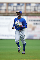 Dunedin Blue Jays outfielder J.D. Davis (5) jogs to the dugout during a game against the Charlotte Stone Crabs on July 26, 2015 at Charlotte Sports Park in Port Charlotte, Florida.  Charlotte defeated Dunedin 2-1 in ten innings.  (Mike Janes/Four Seam Images)