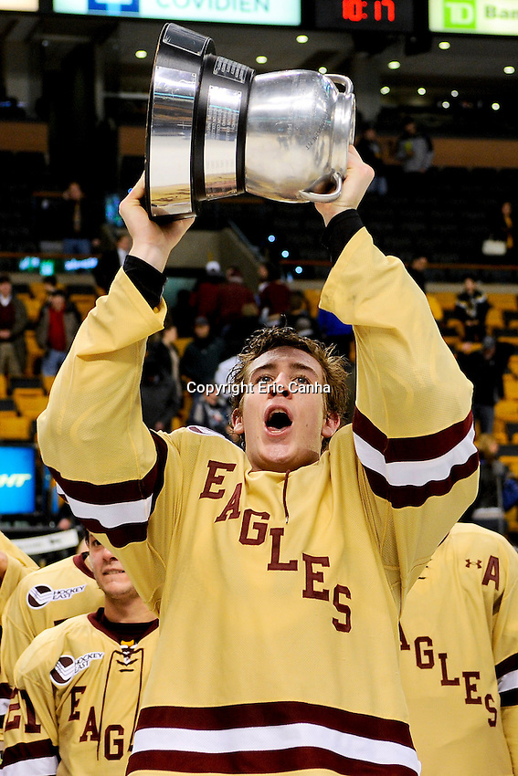 Boston College forward Kevin Hayes (12) hoists the Beanpot trophy after winning the championship round of the Beanpot Tournament hockey between Boston College and Northeastern University held at TD Garden in Boston Massachusetts.  Eric Canha/CSM