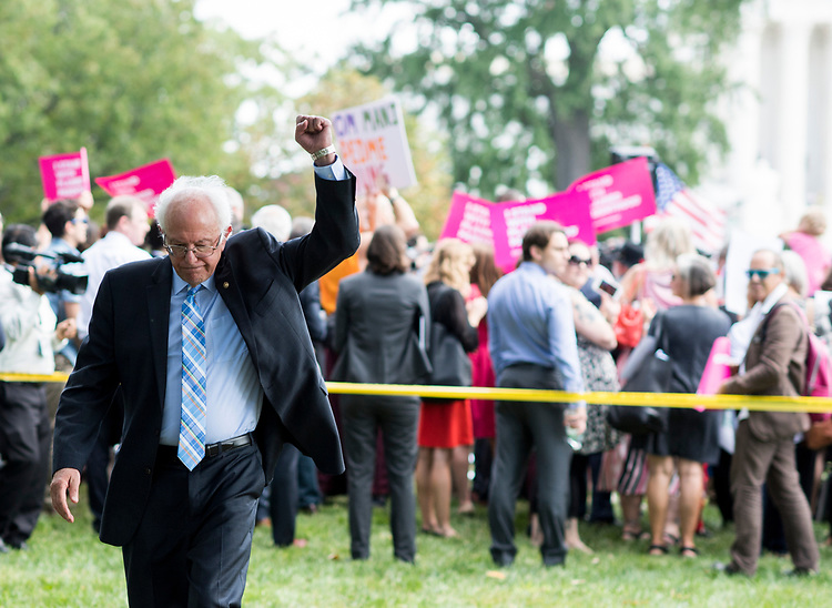 """UNITED STATES - SEPTEMBER 19: Sen. Bernie Sanders, I-Vt., raises his fist as rally attendees chant """"Bernie"""" following his speech to the rally at the Capitol on Tuesday, Sept. 19, 2017. Senate Democrats held the rally to oppose the Senate Republicans's effort to repeal the Affordable Care Act with the Graham-Cassidy proposal. (Photo By Bill Clark/CQ Roll Call)"""