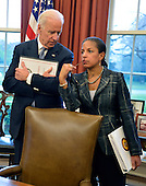 United States Vice President Joe Biden (L) and National Security Advisor Susan Rice confer as US President Barack Obama and Prime Minister Haider al-Abadi of Iraq brief the press in the Oval Office of the White House, April 14, 2015, in Washington, DC. The leaders discussed the strategic partnership between the two countries, support in fighting ISIL as well as commercial and cultural relations.  <br /> Credit: Mike Theiler / Pool via CNP