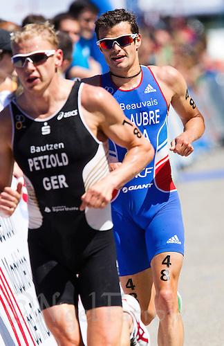 04 JUN 2011 - MADRID, ESP - Frederic Belaubre - Madrid round of triathlon's ITU World Championship Series .(PHOTO (C) NIGEL FARROW)