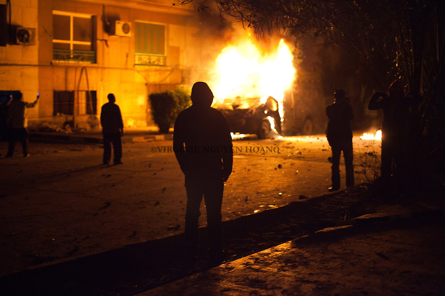 In this Monday, Jan. 28, 2013 photo, clashes have continued for a fifht day in Downtown Cairo between protesters and Egyptian security forces. .Protesters were celebrating the capture of a police truck and put fire on it. .
