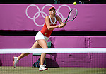 LONDON, ENGLAND - AUGUST 4:  A general view of Maria Sharapova of Russia during the Women's Tennis Final, Day 8 of the London 2012 Olympic Games on August 4, 2012 at Wimbledon Tennis Club in London, England. (Photo by Donald Miralle)