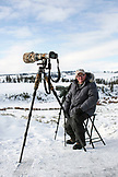 USA, Wyoming, Yellowstone National Park, wolf-watcher Bob Breslaw takes a break from watching a pack on Balcktail Deer Plateau