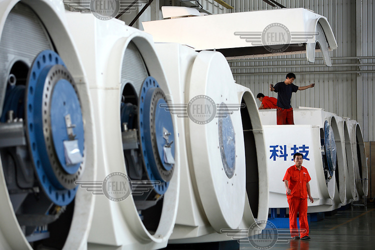 Workers assemble wind turbines at the Goldwind Science & Technology Co. Goldwind is the largest maker of power generating wind turbines in China.