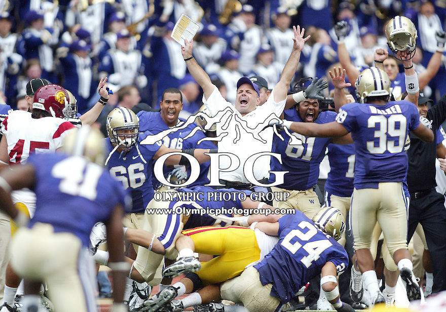 Sep 19, 2009:  Washington offensive line coach Dan Cozzetto and players celebrate as Washington special teams players secure the win against USC.  Washington defeated USC 16-13 at Husky Stadium in Seattle, Washington..