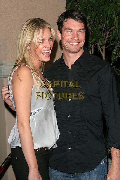 REBECCA ROMIJN & JERRY O'CONNELL.NBC 2006 TCA Winter Press Tour Party - Arrivals held at the Ritz Carlton,Pasadena, California..January 22nd, 2006.Photo: Zach Lipp/AdMedia/Capital Pictures.Ref: ZL/ADM.half length black white top shirt celebrity couple mouth open.www.capitalpictures.com.sales@capitalpictures.com.© Capital Pictures.