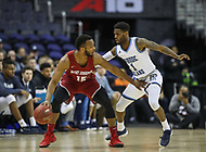 Washington, DC - March 10, 2018: Saint Joseph's Hawks guard Chris Clover (15) is being defended  by Rhode Island Rams guard Jarvis Garrett (1) during the Atlantic 10 semi final game between Saint Joseph's and Rhode Island at  Capital One Arena in Washington, DC.   (Photo by Elliott Brown/Media Images International)