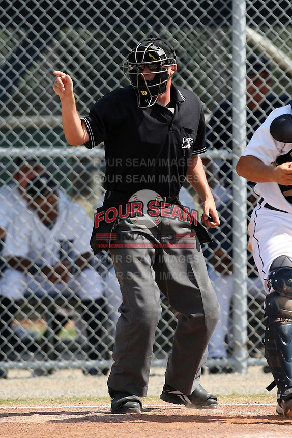 Home plate umpire Shaun Lampe during an Instructional League game between the Detroit Tigers and Philadelphia Phillies at Tiger Town in Lakeland, Florida;  October 12, 2010.  Photo By Mike Janes/Four Seam Images