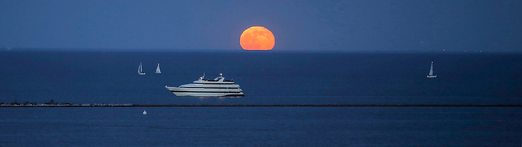 Rising moon over Lake Michigan June, 13, 2014 with sail boats and a cruise ship.(DePaul University/Jamie Moncrief)