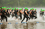 MIDDLEBURY,  CT-061717JS02- Participants make their way into Lake Quassapaug during the Pat Griskus Triathlon Olympics race Saturday at Quassy Amusement Park in Middletown. <br /> Jim Shannon Republican-American